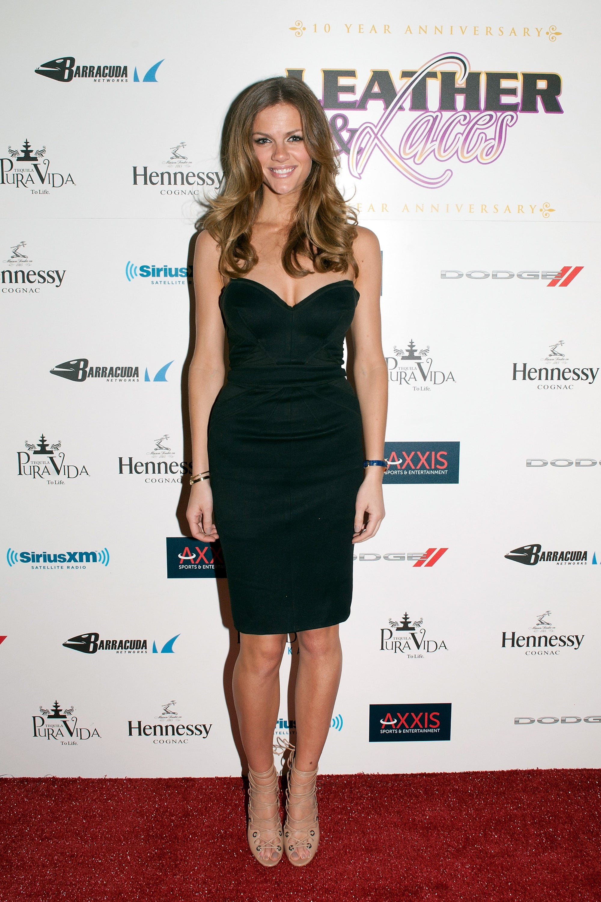 Brooklyn Decker struck a sexy note in a black Zac Posen sweetheart-shaped cocktail dress and nude lace-up sandals.