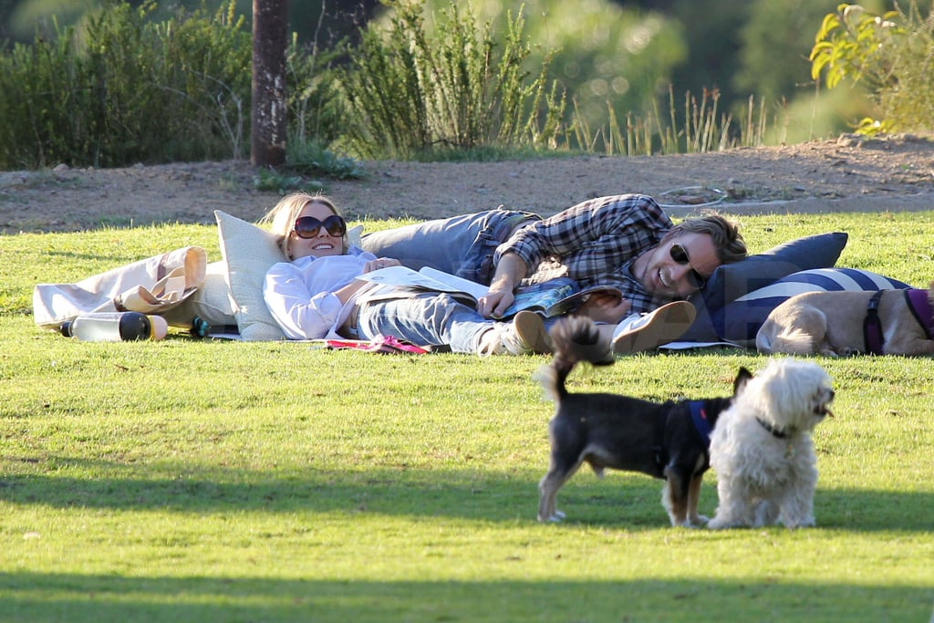 Kristen Bell and Dax Shepard at a park with their dogs.