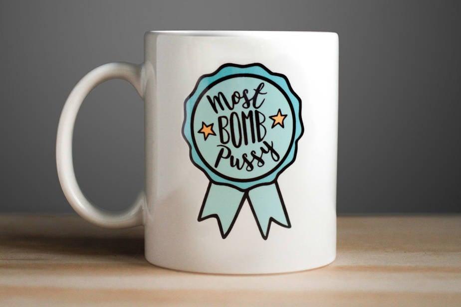 "RapMugs ""Most Bomb P*ssy"" Ceramic Mug"