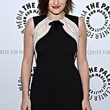 Elisabeth Moss wore a formfitting black-and-white dress.
