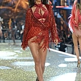 Irina first took the catwalk in this fiery, fringed outfit.