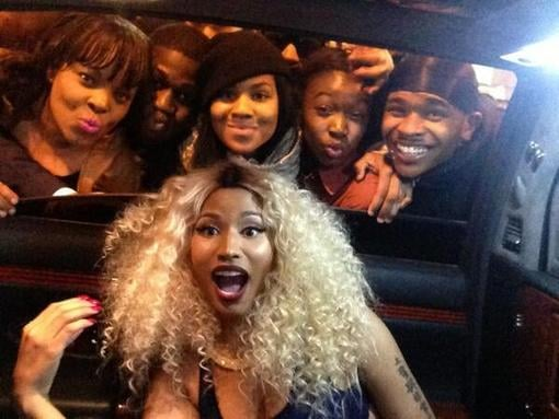 Nicki Minaj posed with a group of fans while inside her limo. Source: Twitter user NICKIMINAJ