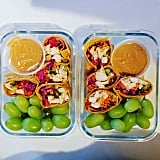 Thai chicken salad wraps, dipping sauce, and green grapes.