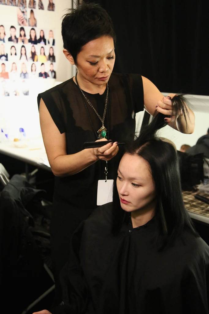 "Jeanie Syfu for Tresemme created the simple, sleek hair. ""It's all about a good blowout,"" she said. She started off with the brand's Thermal Creations Volumizing Mousse and Keratin Smooth Heat Protection Shine Spray to protect the hair from heat styling. Once the hair was blown out, she sprayed on 24-Hour Body Finishing Spray before going through the hair with a flat iron to make the models' strands completely smooth and straight. She also added extensions underneath the models' own layers, so she could give them all a blunt cut to add to the structured feeling. ""This way it looks really edgy, not retro,"" she said."
