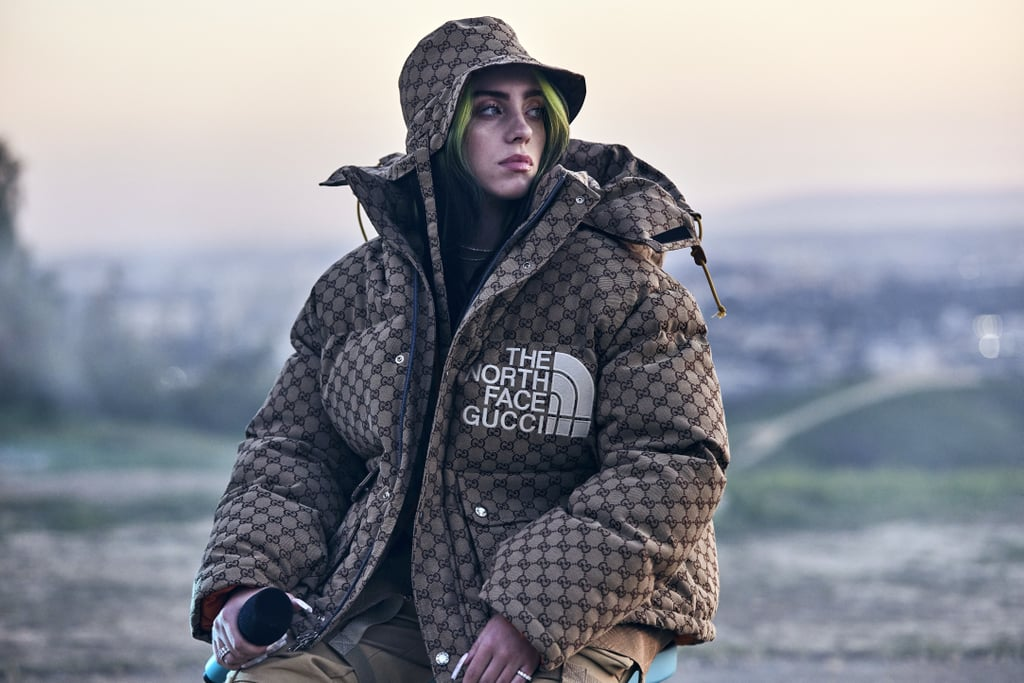 Billie Eilish's closet is filled with bright, comfortable, monochromatic designer ensembles, and on Feb. 25, she rocked a highly coveted coat that we can't stop gawking at. During the premiere event for her Apple TV+ documentary film, Billie Eilish: The World's a Little Blurry, the 19-year-old powerhouse pulled out the trendy puffer jacket from Gucci and The North Face's collaboration. Billie paired the camel GG canvas down coat with a matching Gucci bucket hat, beige pants, and a Gucci T-shirt. It's no wonder that Billie chose that coat for her big premiere — ever since the collection released in January, it's been sought after by celebrities like A$AP Rocky and street style fanatics alike. With the release of her documentary, Billie announced a new clothing collection including sweatshirts, socks, T-shirts, and sweatpants that she designed to reflect the film's message. In an Instagram post, she shared that every item (with the exception of the socks) was made from organic fabrics grown without pesticides in the US in order to support the local economy and save on international shipping costs. Check out photos of Billie rocking the Gucci x The North Face puffer jacket ahead, and make sure to check out her documentary on Apple TV+ starting Feb. 26.      Related:                                                                                                           Billie Eilish Just Took Me Back to the Days of the Ultra-Rip Jean, and Somehow I Feel More Whole