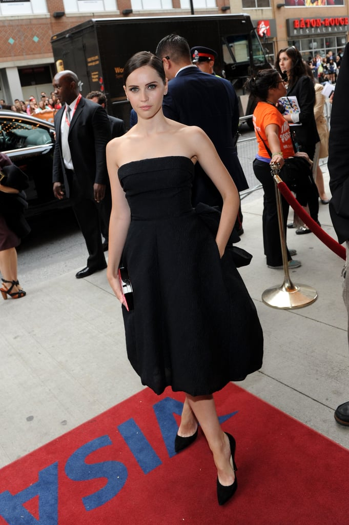 Felicity Jones put her décolletage on display in a black strapless Dior dress and black pumps at The Invisible Woman premiere.