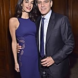 At an event for The 100 Lives Initiative, Amal color-coordinated with her husband, George, in an indigo sheath dress with lace cutouts.
