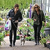 Kate Moss and Jamie Hince walked their dog through a London garden on Wednesday.
