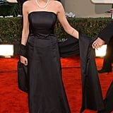 A the 2002 Golden Globe Awards wearing another black strapless gown.