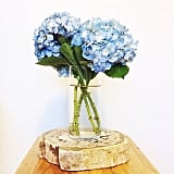 With large flowers like hydrangeas, you only need a couple to fill out a vase.  Source: Instagram user natalie_dressed