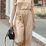 For an afternoon out in Los Angeles, Behati wore a loose silk dress.