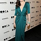 Rose McGowan matched her turquoise drop earrings to her jewel-toned gown.
