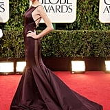 From the dramatic plum hue to the sexy sheer paneling to the darlingly low back detail, this statement-making Donna Karan creation had every Golden Globe Awards attendee staring.