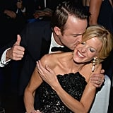 Aaron Paul gave Anna Gunn a kiss at the 2013 Emmys Governors Ball.