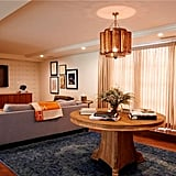 The second living area features an equally as stylish light fixture and decor.