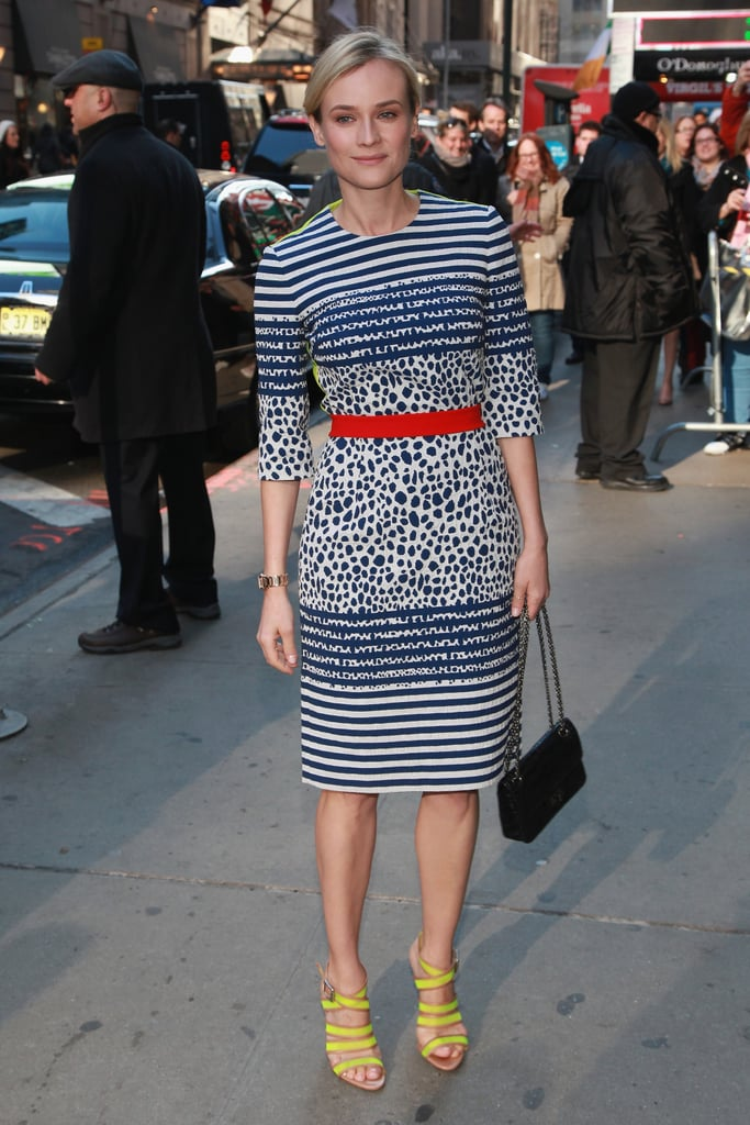When she took off her coat, Diane revealed all of her fashionable printed Preen dress.