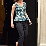 A Peplum Top and Black Trousers Is Always a Ladylike Look . . .