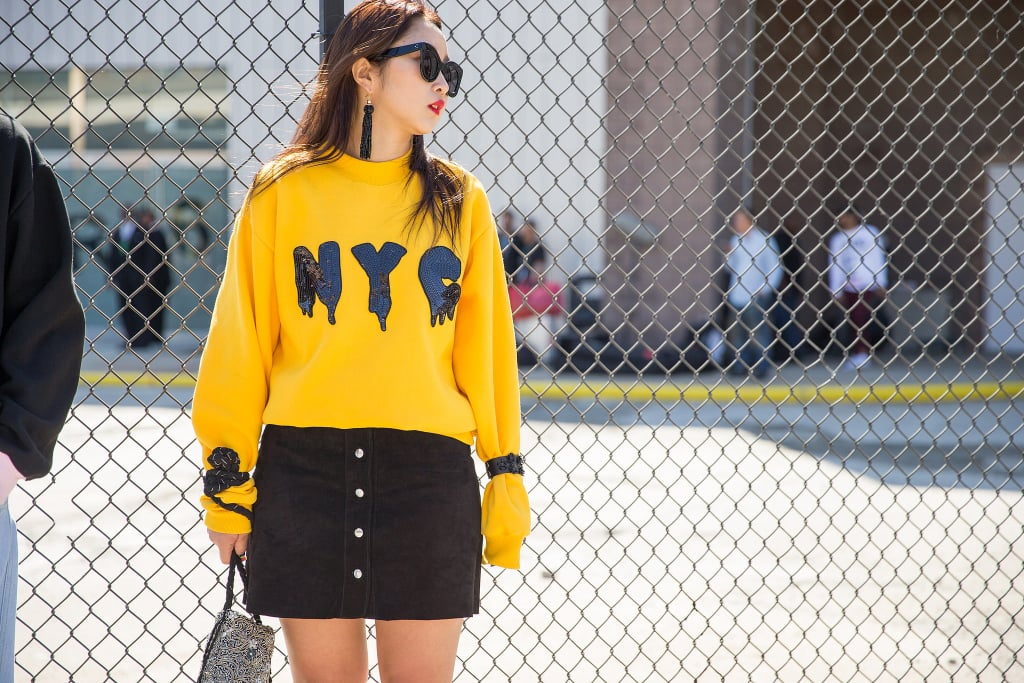 A Graphic Sweater to Be Accessorized With Statement Earrings and Shades