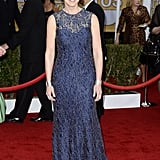 Nurse Jackie star Edie Falco accessorized her navy lace overlay Chagoury Couture gown with wide silver cuffs and sapphire earrings.