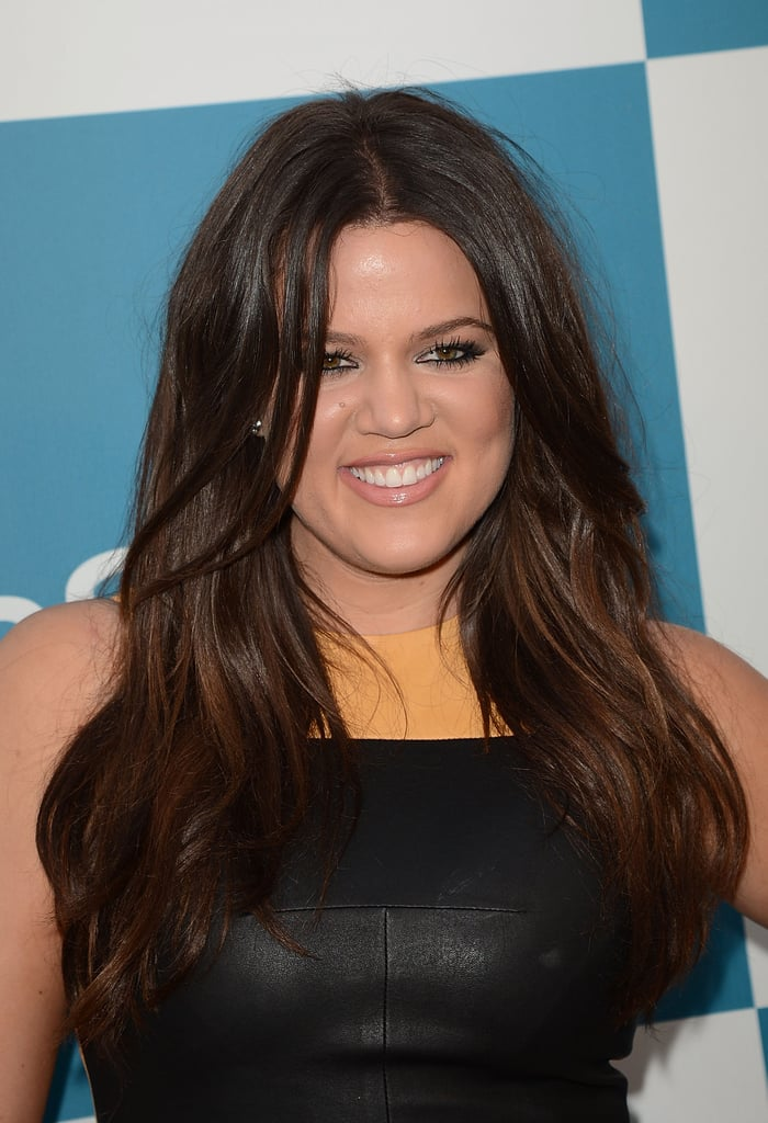 Khloé Kardashian flashed a smile.