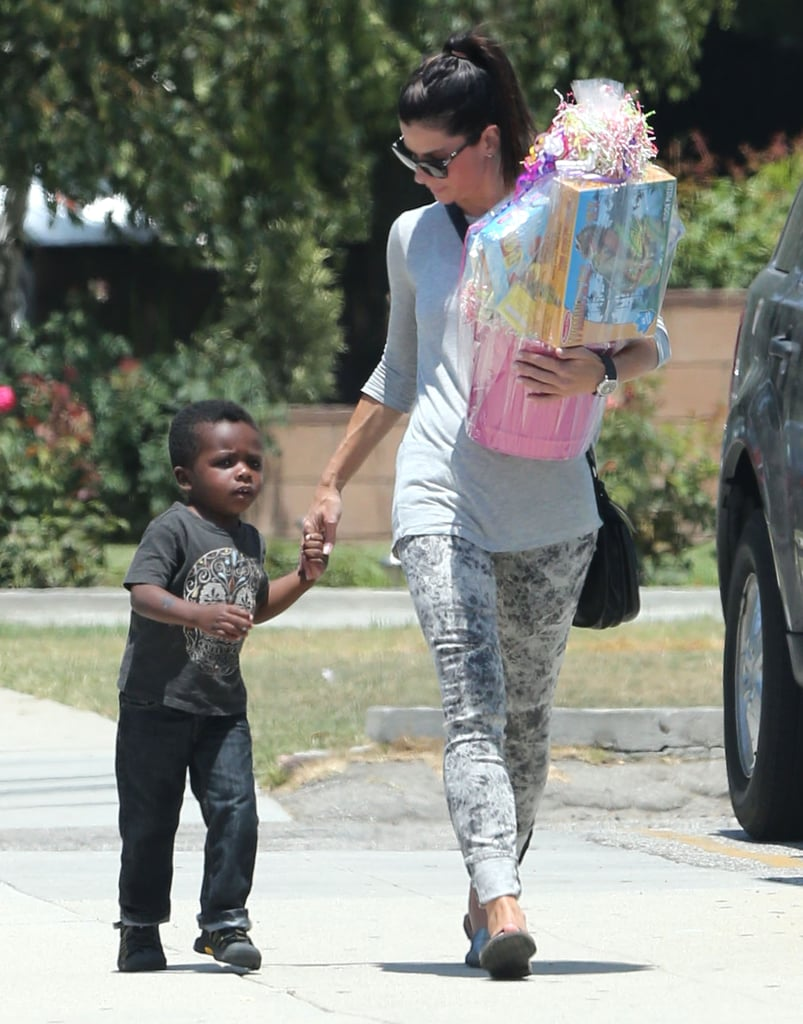 Sandra Bullock held her son Louis's hand on the way to a ...