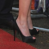 Red toes to match her Louboutin heels and the (soggy) carpet.