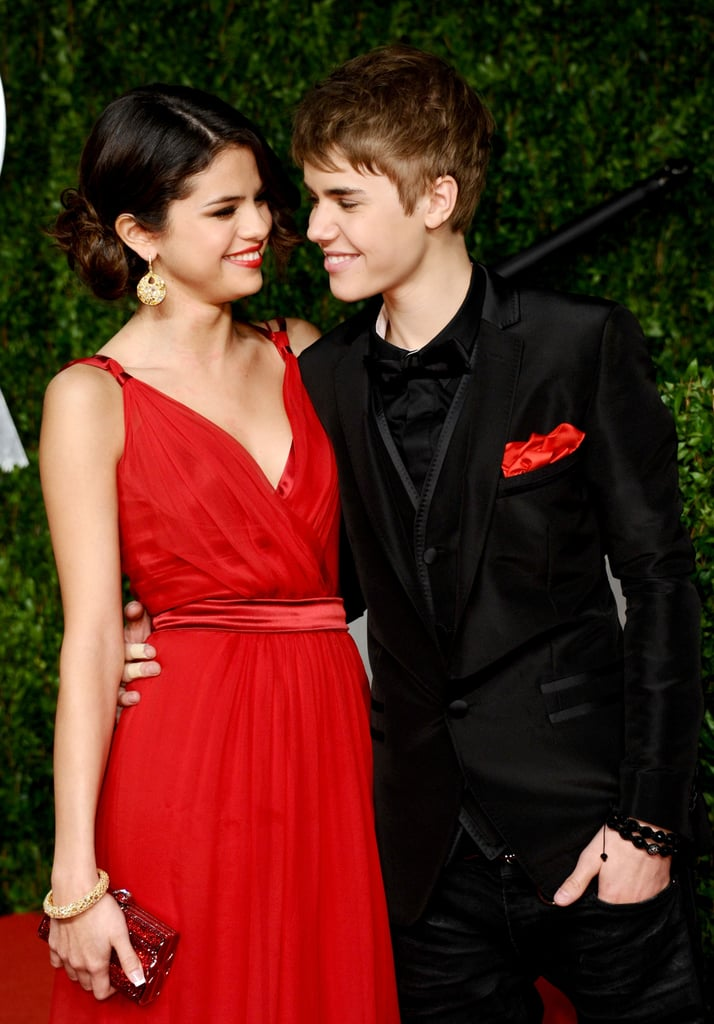 Justin Bieber and Selena Gomez scored invites to the Vanity Fair Oscars party this evening — check out tons of red carpet and fun pictures inside the event! The hot young couple held hands on their way in and snuggled on a couch once inside the bash. Justin matched his pocket square to Selena's hot red gown — weigh in on her look — and they were both wearing Dolce & Gabbana! The two didn't attend the star-studded Academy Awards, but they looked like they were having a blast joining in the scene of Hollywood's biggest night. Justin and Selena gazed into each other's eyes and showed off a little of their famous affection with PDA. Stay tuned for tons more from all the events all over town and weigh in with all of Fab and Bella's polls!