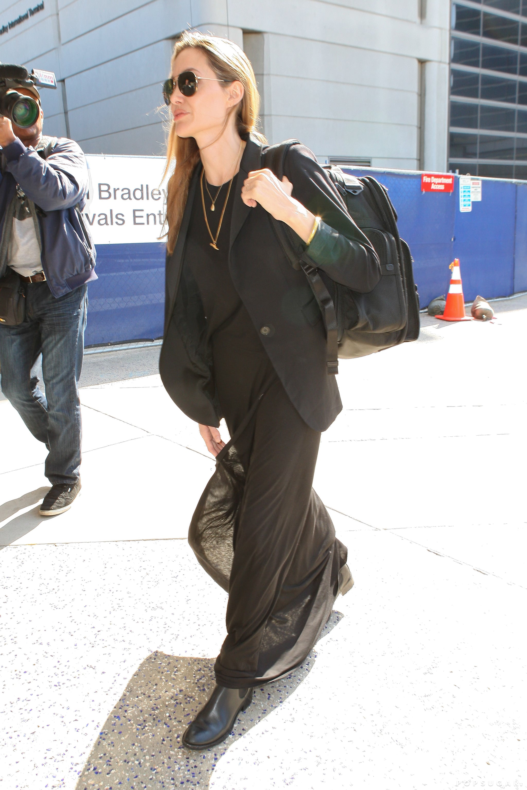 Angelina Jolie carried a backpack at LAX.