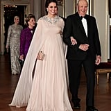 For the official dinner at the Royal Palace in Oslo on Feb. 2018, Kate walked down in this stunning Alexander McQueen cape creation. To finish her royal ensemble, Kate wore a pair of the queen's sparkling pendant earrings along with the queen's bracelet, which was a wedding gift from Prince Philip.