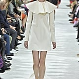 We can imagine Melania shopping the Valentino Spring 2018 collection for something lightweight, but statement-making. The ruffled collar on this ivory shift would help her stand out.
