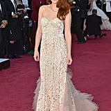 Kristen Stewart posed in a Reem Acra gown on the Oscars red carpet.