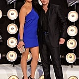 Rapper Pitbull arrives with his date close to him.