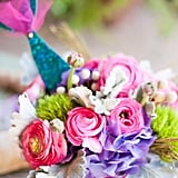 Vendors:  Photographers: Nicole Anderson and Alicia Cho Event Coordinator/Designer, Invitations, and Catering: Lady Liberty Events Cake: Charm City Cakes Braids and Entertainment: The Celebration Entertainment Live Mermaid: Sheroes Entertainment LLC Event Rentals: Town & Country Rentals