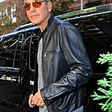 George Clooney wore a black leather jacket to leave his hotel in NYC.