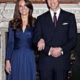 29 years later, Kate chose to show off Diana's sapphire with a blue silk jersey dress from Issa.