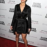 Jennifer Lawrence selected yet another Christian Dior number at an event in Los Angeles, wearing a black satin jacket as a dress with black pointy pumps.