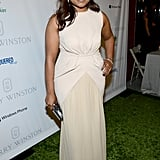 Mindy Kaling donned an elegant off-white Max Mara gown.