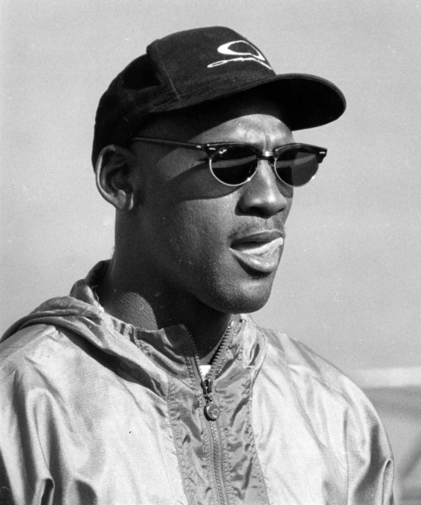 Michael can be seen wearing a windbreaker and classic pair of Ray-Ban sunglasses in this suave black-and-white shot taken in 1994.