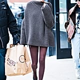 On day two of NYFW, the model matched her brown tights to her oversize brown knit sweater and Chanel slingbacks. She accessorised her outfit with Andy Wolf Florence sunglasses.