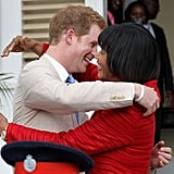 Harry embraced Prime Minister of Jamaica, Portia Simson-Miller, at the Devon House in 2012.