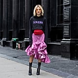 We love Lisa Hahnbueck's unexpected red fanny pack that she cinched around her pink ruffled skirt. Talk about mastering the trend while also bringing back a nostalgic accessory.