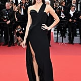 Model Isabeli Fontana slipped into a one-shouldered gown for The Unknown Girl's premiere.