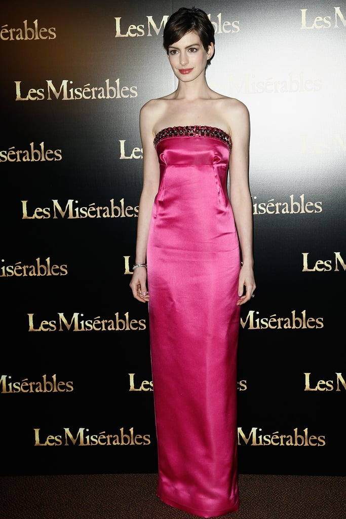 Anne Hathaway took the Paris premiere of Les Misérables by storm in a bold fuchsia-hued Prada column gown. But the best part? The gorgeous red crystal embellishments along the neckline.
