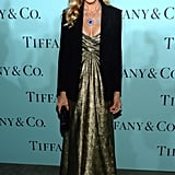 Sarah Jessica Parker shimmered in a vintage Vicky Tiel gold strapless worn under a black blazer by Yeojin Bae, Tiffany round fringe earrings ($90,000), a round fringe necklace ($50,000), a round tanzanite and diamond drop pendant ($265,000), round tanzanite diamond earrings ($50,000), round tanzanite and diamond ring in ($40,000) — all from 2013 Blue Book Collection — and finished off her look with a Tiffany onyx crocodile clutch ($2,500).