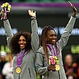 Serena and Venus Williams were all smiles while accepting their medals after winning gold for the women's tennis doubles title.