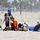 Nicole Richie played with Harlow and Sparrow as Joel Madden took in a book on the beach in Malibu for Easter.