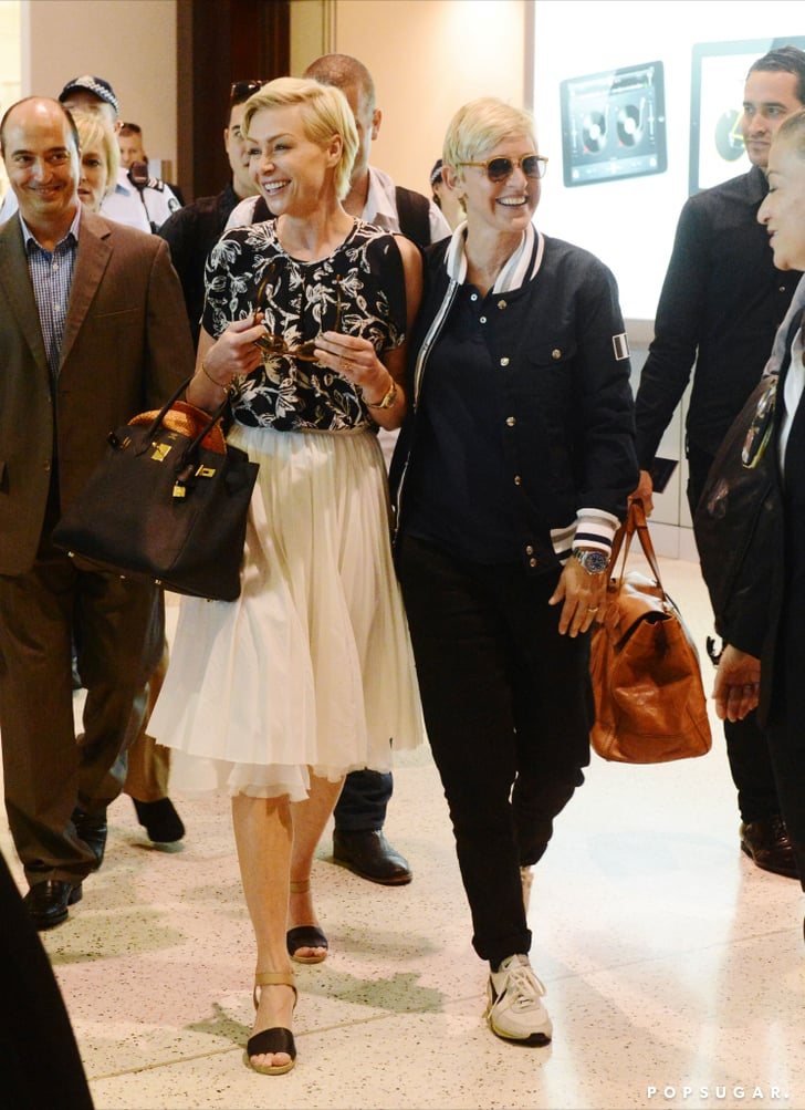 Ellen DeGeneres and Portia de Rossi walked through an airport in Australia.