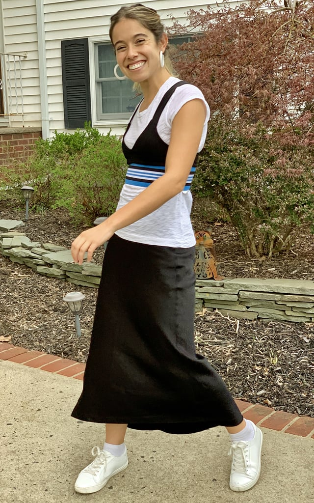 I added Lucite hoops and slipped into a silk midi skirt (which still feels totally '90s to me) instead of trying on Cher's biker shorts. I did wear this outfit to the office, after all.
