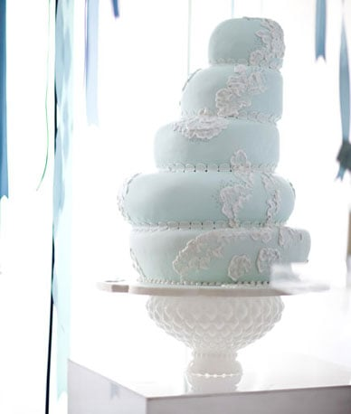 With its ornate base, this hobnail milk glass pedestal is quite the showstopper, and yet it still highlights the main attraction — the cake. Photo by Caroline Tran via Source