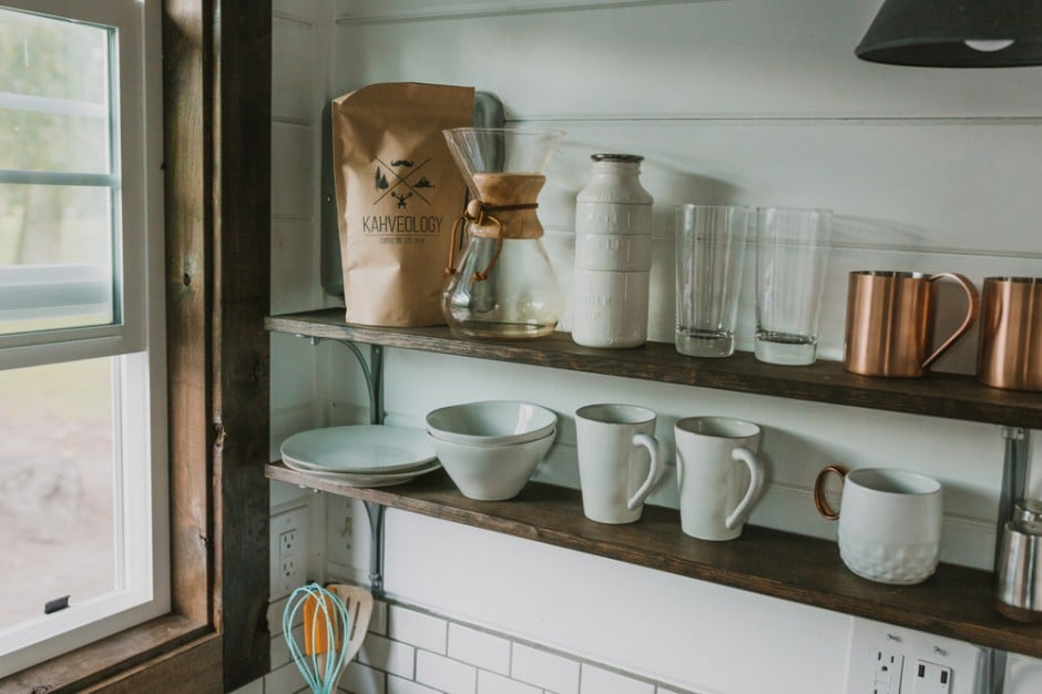Floating shelves consume less space than cabinets but require organization. The trick? Owning only what you need, embracing stackable pieces, and color coordinating when possible.